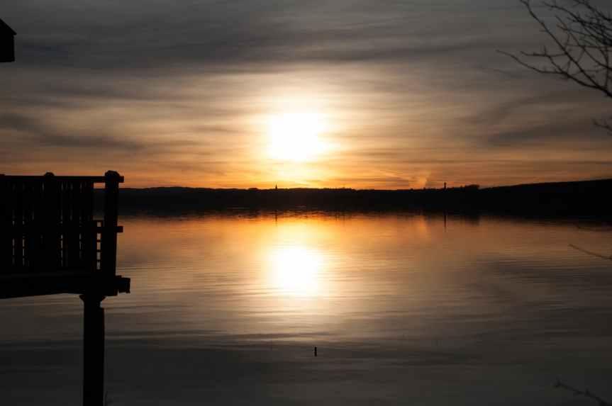 backlit beach boat dawn